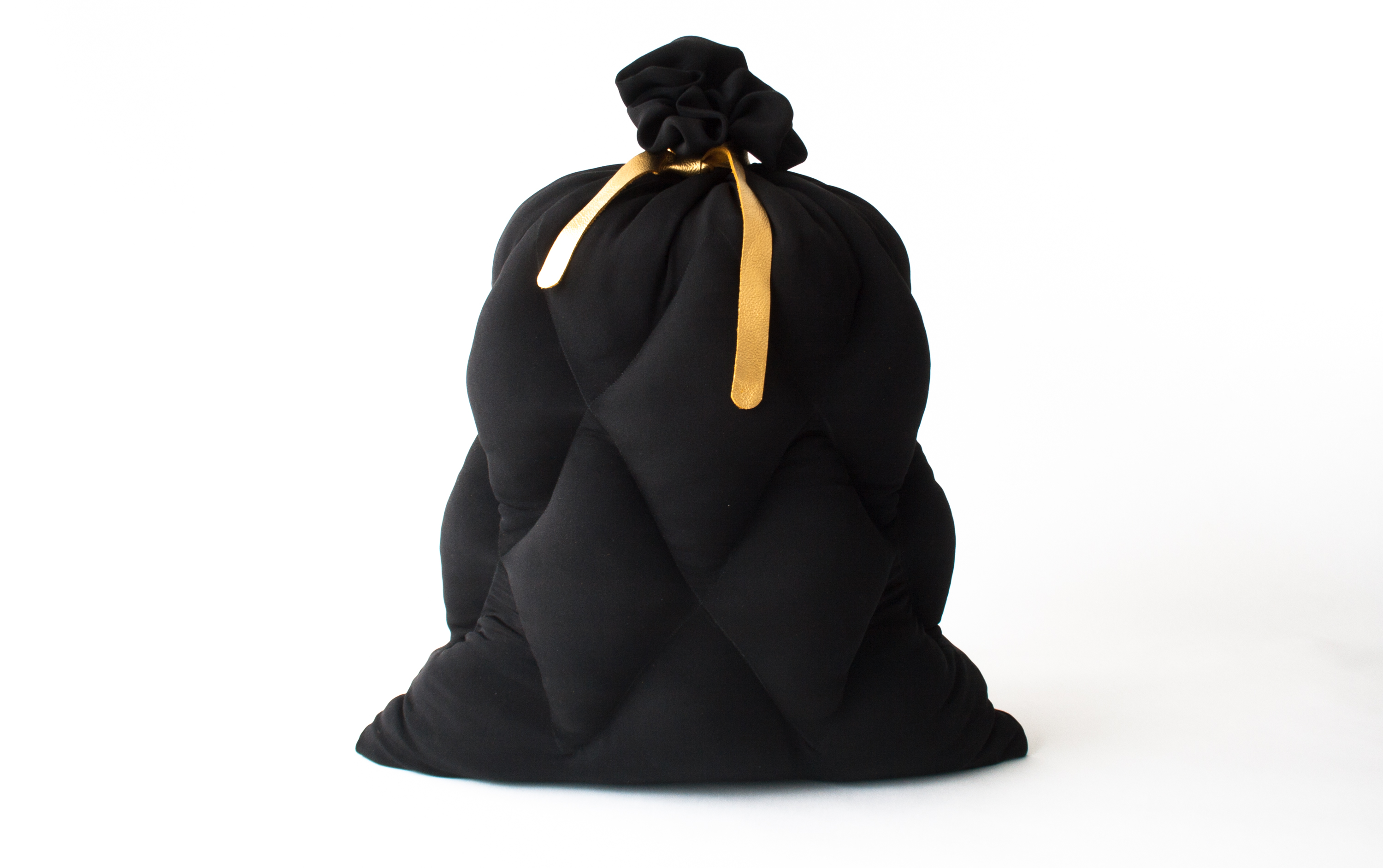 Limited Garbage, a limited edition silk pillow in the shape of a garbage bag, designed by Jarle Veldman